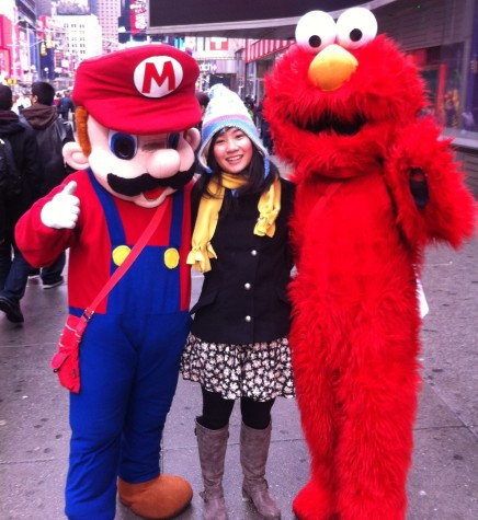 Junior Annie Zheng poses with characters in Times Square.  (Photo courtesy: Annie Zheng)