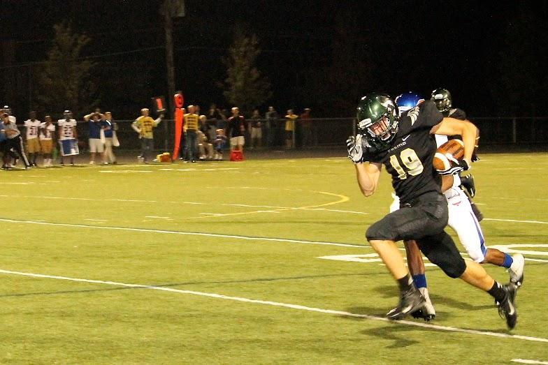 Senior+wide+receiver+Kyle+Lewis+races+down+the+sideline+during+his+77-yard+catch+for+a+touchdown.