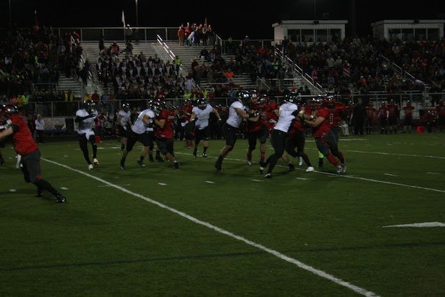 The Vikings defend against the run in the game against Palatine on Oct. 10.