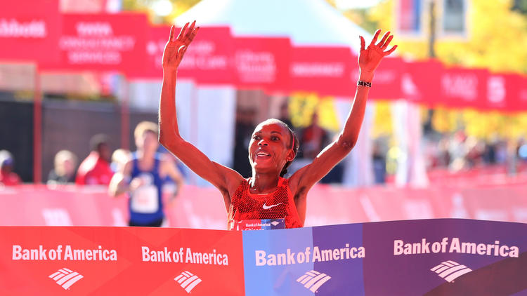 Rita Jeptoo of Kenya defends the woman's title with a time of 2:24:35. Photo courtesy of Chicago Tribune.