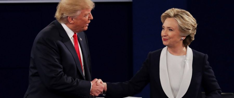 Hillary+Clinton+and+Donald+Trump+shake+hands+before+the+second+Presidential+Debate.+