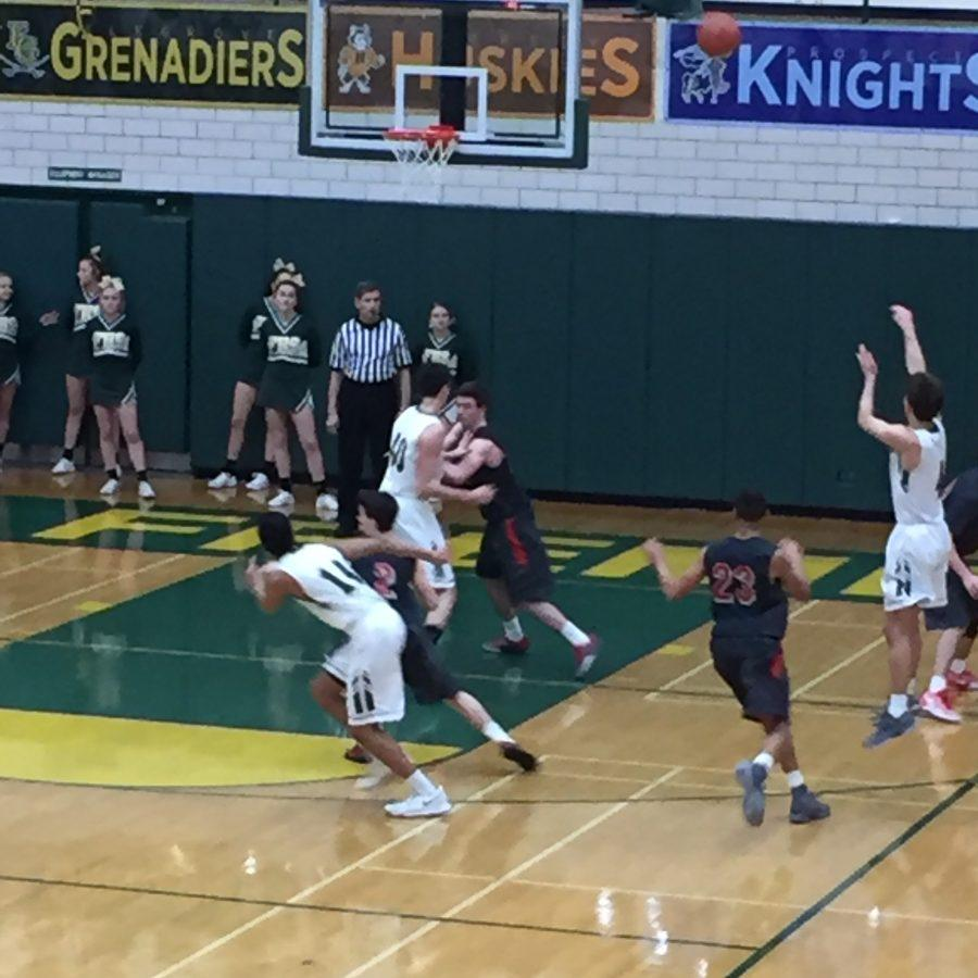 Boys basketball finishes undefeated regular season with 46-32 win over crosstown rival Palatine