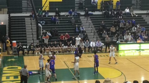 Strong second-half effort lifts boys basketball over Rolling Meadows